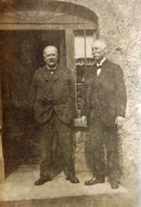 Photograph of William McWilliam & James Henry, solicitors, outside Holly Lodge